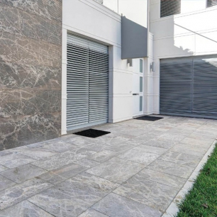 Chimney: Ambrato Silk / Wall Cladding: Tango Sandblasted / External Floor Tiles: Ambrato Chianca
